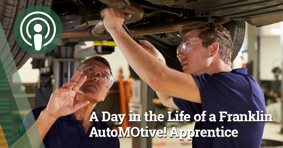 Franklin automotive apprentice underneath a vehicle makes an adjustment with a wrench under the direction of a trained teacher.